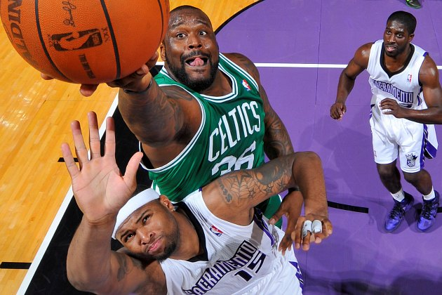 Shaquille O'Neal shoots over DeMarcus Cousins in 2011 (Rocky Widner/ Getty).