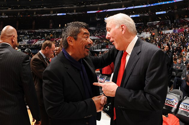 Gregg Popovich chats with funnyman George Lopez at the 2011 All-Star Game (Andrew D. Bernstein/ Getty).