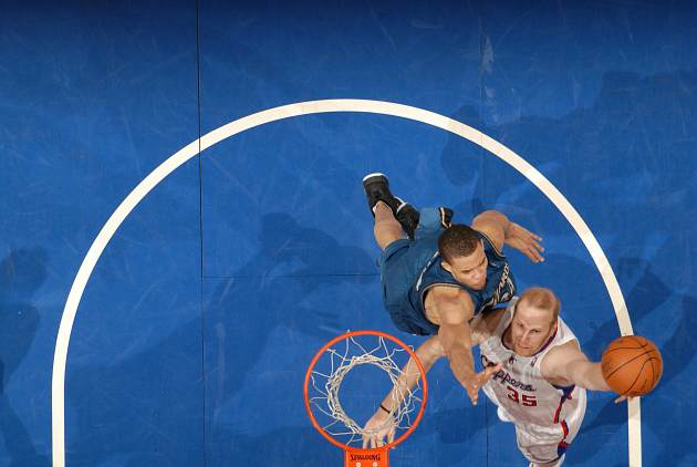 Chris Kaman battles with JaVale McGee, aka Mr. Watchability (Andrew D. Bernstein/ Getty).
