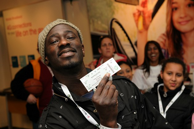 A Celtics fan shows off his ticket (Darren McCollester/ Getty).