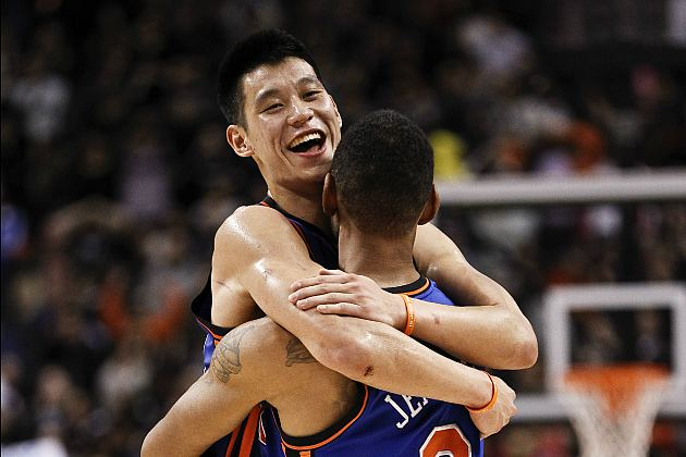 Jeremy Lin hugs Jared Jeffries, whom no one wants to watch on TV (Jeff Zelevansky/Getty).