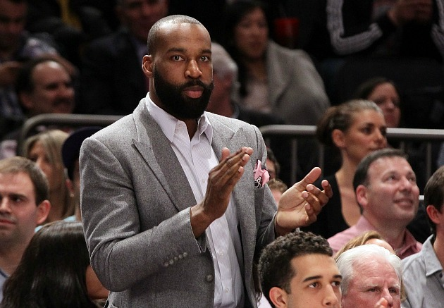 Baron Davis gets dapper on the Knicks bench (Jim McIsaac/ Getty).