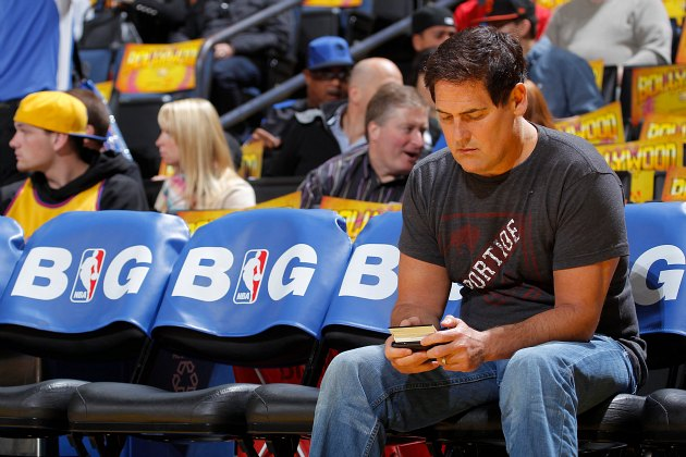 Mark Cuban checks Craigslist for available superstars (Rocky Widner/ Getty).