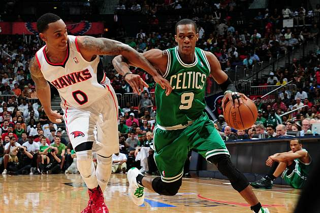 Rajon Rondo dribbles past Jeff Teague (Scott Cunningham/ Getty).