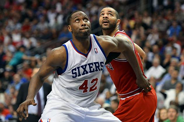 Elton Brand boxes out Carlos Boozer, but whatever (Drew Hallowell/ Getty).