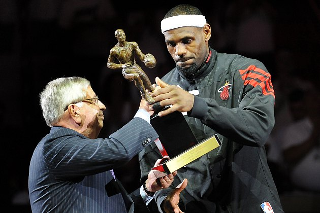 David Stern tests the strength of LeBron James (MCT via Getty Images).