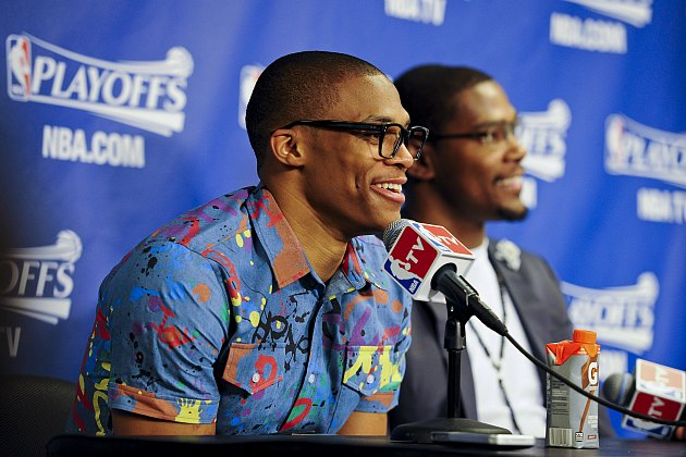 "Russell Westbrook shows off his ""fingerpaint casual"" look (Andrew D. Bernstein/ Getty)."