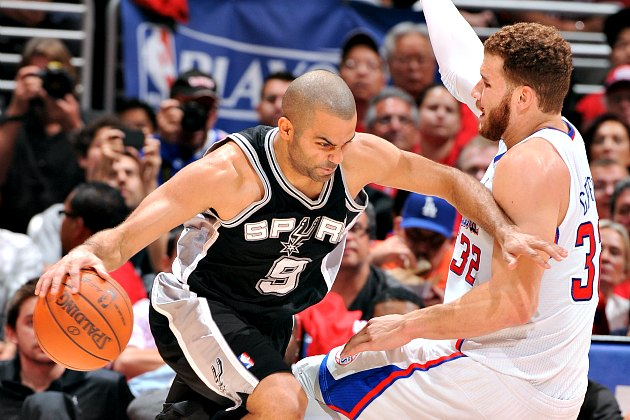 Tony Parker drives, Blake Griffin falls, and an NBA employee decides a fine (Andrew D. Bernstein/ Getty).