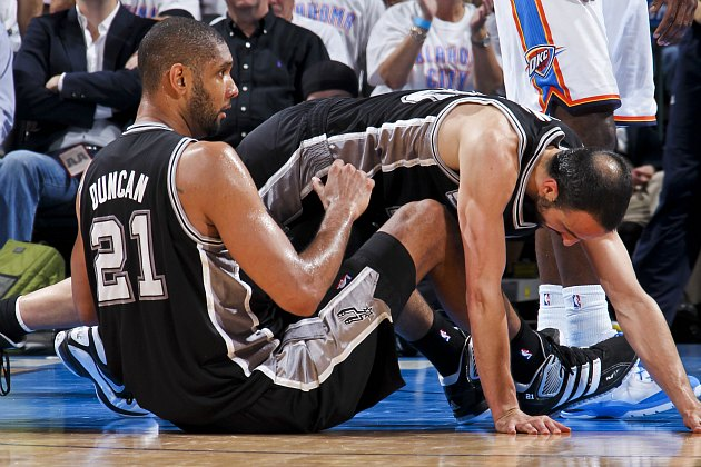 "Tim Duncan and Manu Ginobili execute the rare ""Whispering Lion"" flopping technique (Layne Murdoch/ Getty)."