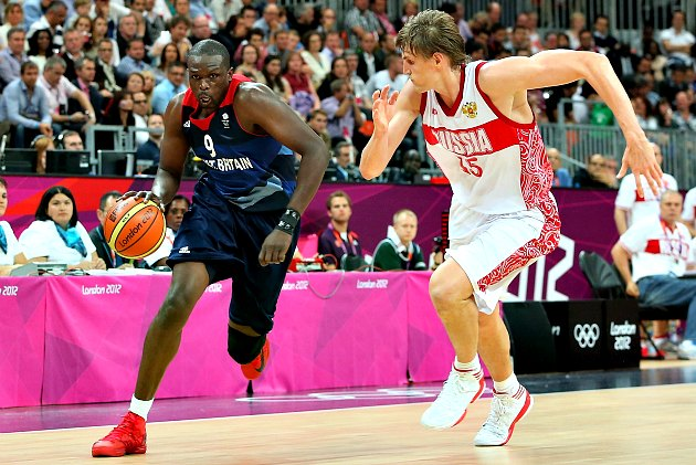 Andrei Kirilenko prances next to Luol Deng (Christian Petersen/ Getty).