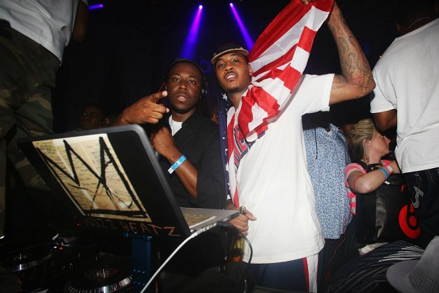 Carmelo Anthony parties with music producer Swizz Beatz (Ben Pruchnie/ WireImage).