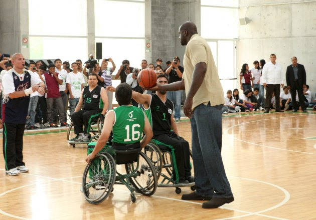 Shaquille O'Neal throws the tip at a wheelchair basketball game in Mexico (Jesse Grant/ WireImage).