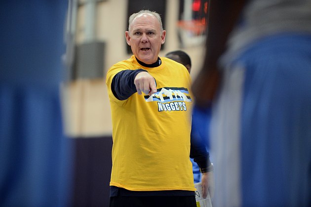 George Karl explains the principles of longitude to his team (Garrett Ellwood/ Getty).