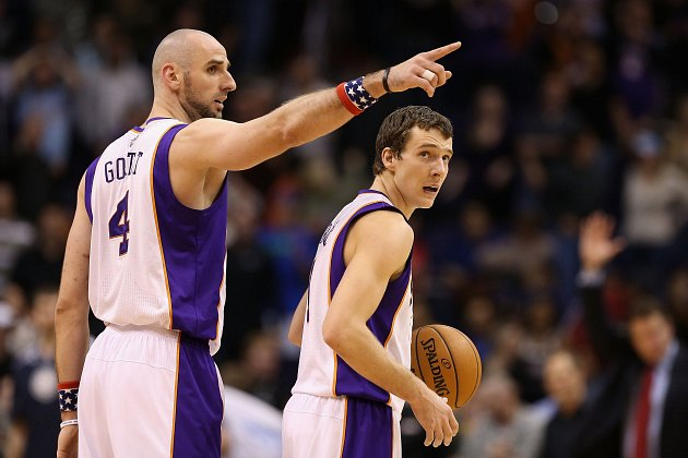 "Marcin Gortat to Goran Dragic: ""Avast! Land ho!"" (Christian Petersen/ Getty)."