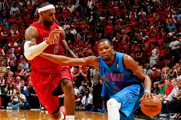 Kevin Durant holds off LeBron James as best he can (Isaac Baldizon/ Getty).