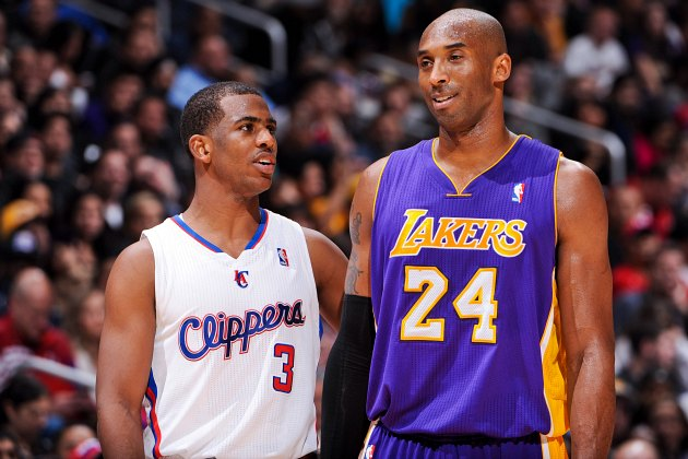 Chris Paul and Kobe Bryant discuss basketball-related income (Andrew D. Bernstein/ Getty).