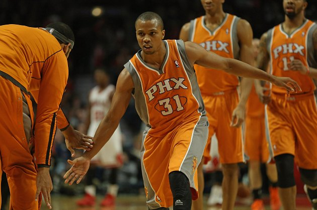 Sebastian Telfair celebrates his purchase of the new Norah Jones album (Jonathan Daniel/ Getty).