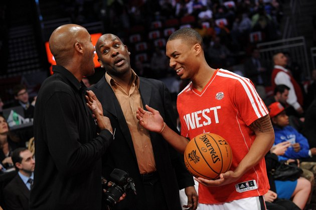 Lillard laughs with Gary Payton and Sam Cassell before the Skills Challenge (Noah Graham/ Getty).