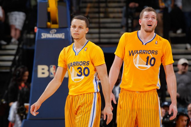 Stephen Curry and David Lee look thrilled to wear sleeves (Rocky Widner/ Getty).