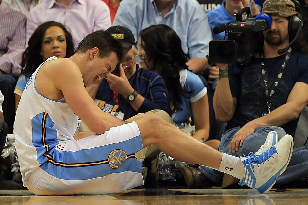 Danilo Gallinari sits on the court in pain after injuring his left knee (Doug Pensinger/ Getty).