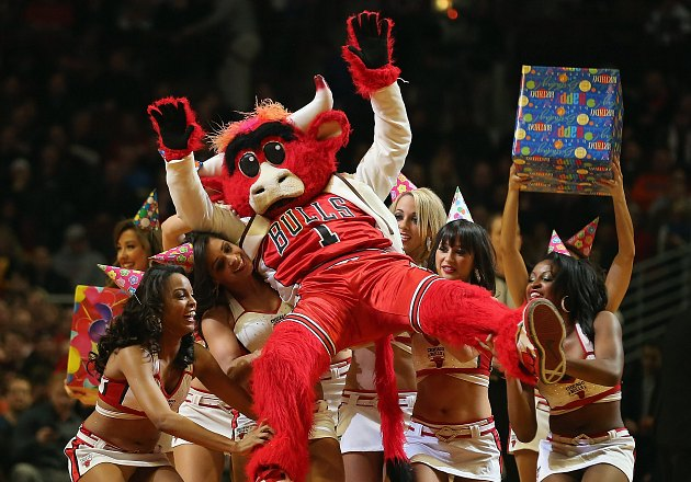 Benny the Bull is carried in the arms of cheerleaders (Jonathan Daniel/ Getty).