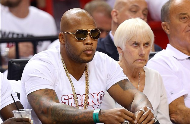 Flo Rida attends Game 1 of the NBA Finals. The woman to his left is not his manager (Mike Ehrmann/ Getty).