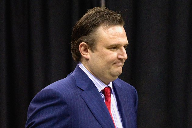 Daryl Morey prepares to tell all the Rockets they've been traded (Bob Levey/ Getty).