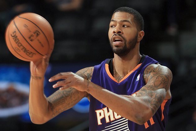 Markieff Morris makes a pass in preseason action (Doug Pensinger/ Getty).