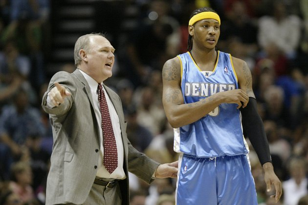 George Karl informs Carmelo Anthony he has been traded to Mars (Brian Bahr/ Getty).