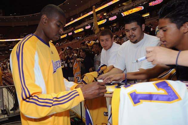 Andrew Bynum begrudgingly signs autographs for heartless jerks in 2008 (Andrew D. Bernstein/ Getty).