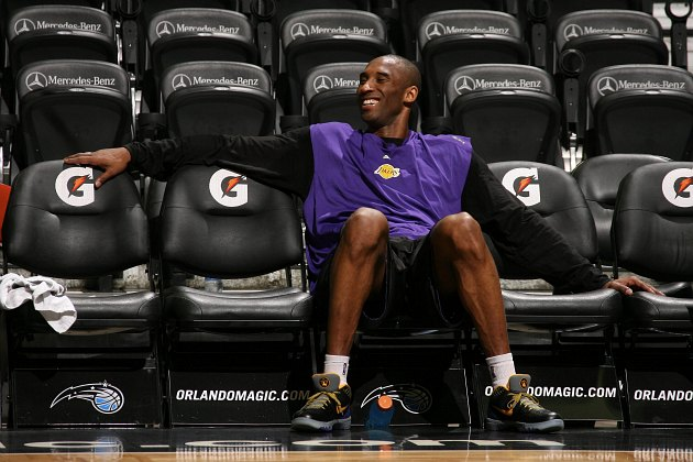Kobe Bryant laughs with friends before a 2009 NBA Finals game (Nathaniel S. Butler/ Getty).