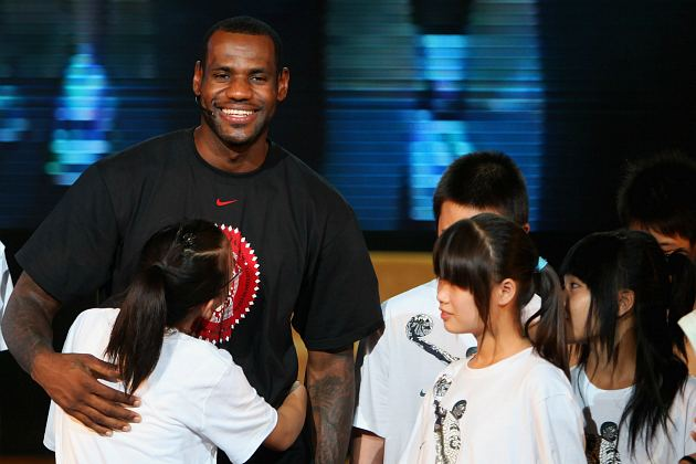 LeBron James tells his Chinese fans about the wonders of high fructose corn syrup (Feng Li/ Getty).