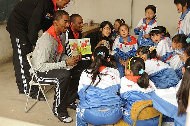 J.R. Smith reads a children's book to his Chinese fans (Andrew D. Bernstein/Getty).