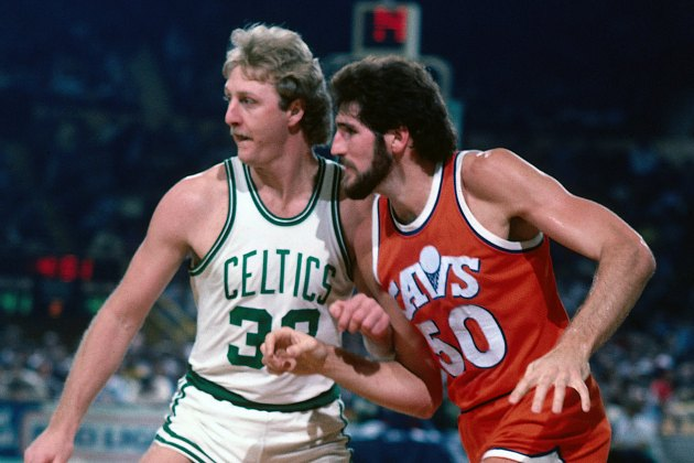 Larry Bird and Ben Poquette compare hair (Dick Raphael/ Getty).