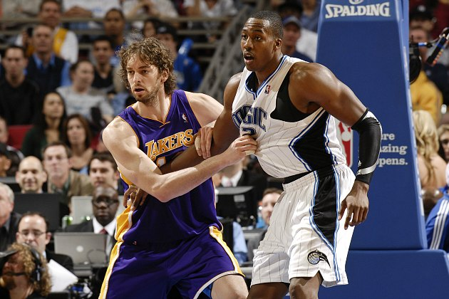Pau Gasol tries to take off Dwight Howard's Orlando jersey (Fernando Medina/ Getty).