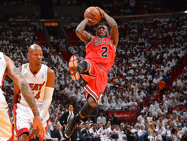 A very Nate Robinson shot is about to go up. (Jesse D. Garrabrant/NBAE/Getty Images)