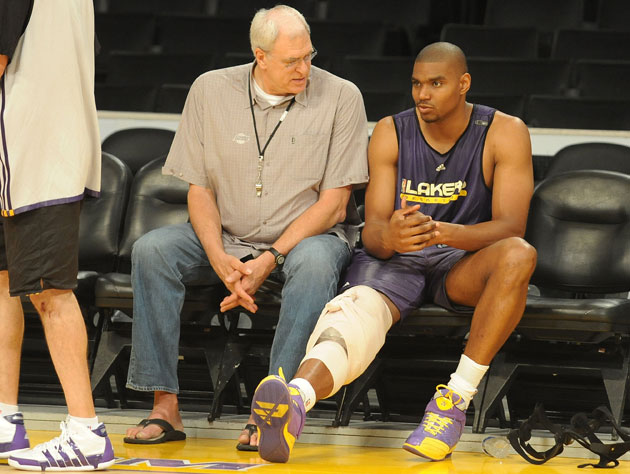 Phil Jackson consults Andrew Bynum in 2011 (Getty Images)