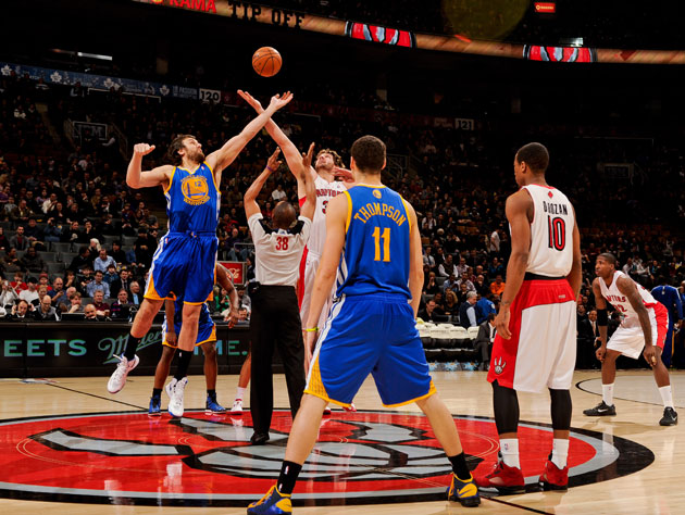 Andrew Bogut tips off against Toronto (Getty Images)