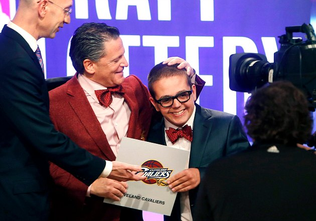 Nick and Dan Gilbert (left) celebrate the Cavaliers' lottery win (Nick DeCrow/ Associated Press).