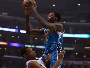 Al-Farouq Aminu rides Willie Green. (Getty Images)