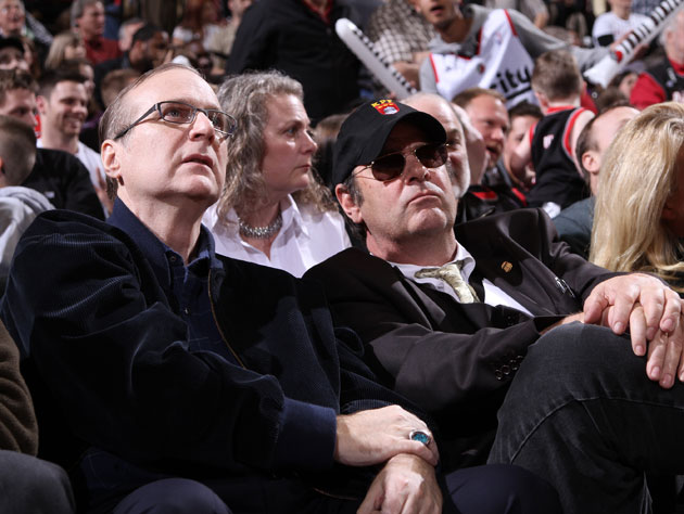 Paul Allen checks the score, Dan Aykroyd checks for aliens (Getty Images)