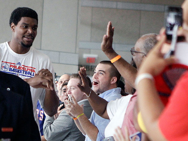 Andrew Bynum weighs his options. (AP)