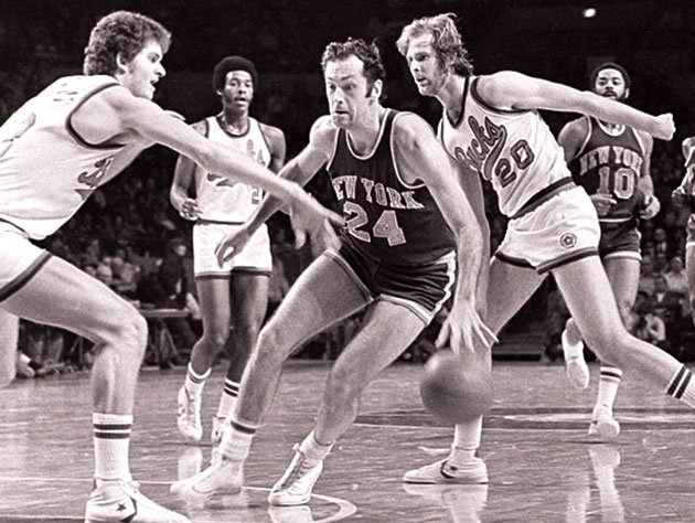 Bill Bradley dribbles past a young Dirk Nowitzki in 1970 (Getty Images)