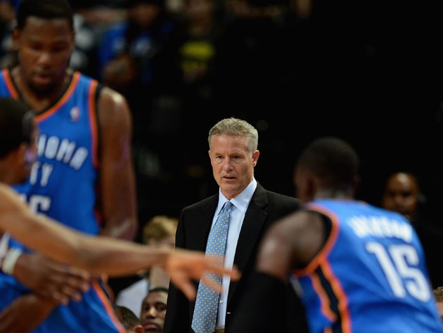 Brett Brown watches, and judges. (Getty Images)