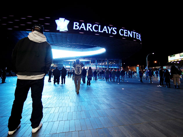 A fan wears an outfit outside Barclays Center that is inappropriate for mid-July (Getty Images)