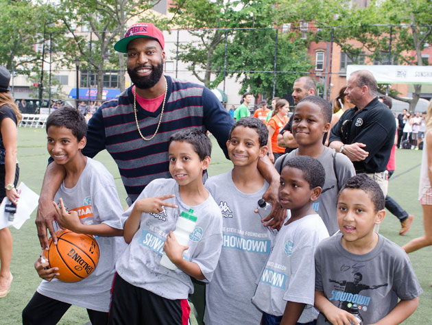 Baron Davis pals around with fans in June (Getty Images)