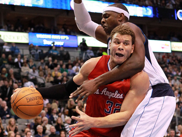 Blake Griffin gets wrapped up by Dallas' Brendan Haywood (Getty Images)