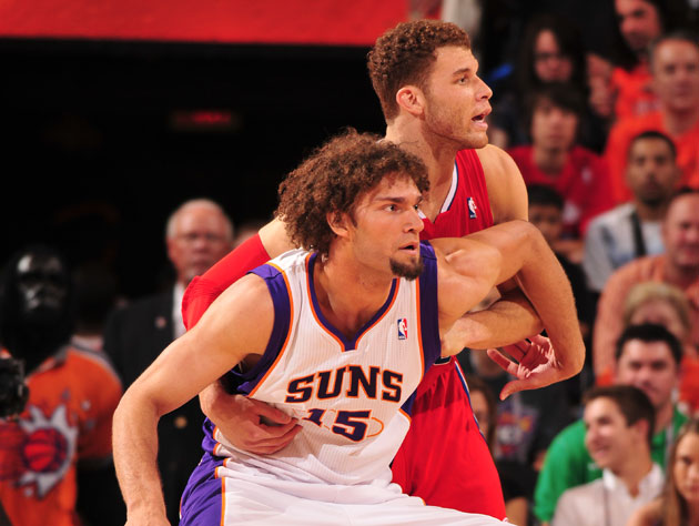 Robin Lopez prepares to pick Blake Griffin up and throw him through a saloon window (Getty Images)