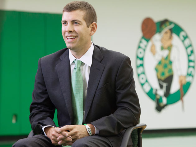 "Brad Stevens perfects his ""hey, I'm at a parade!""-face. (Getty Images)"