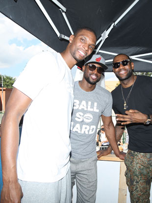 Chris Bosh and two other guys (Getty Images)